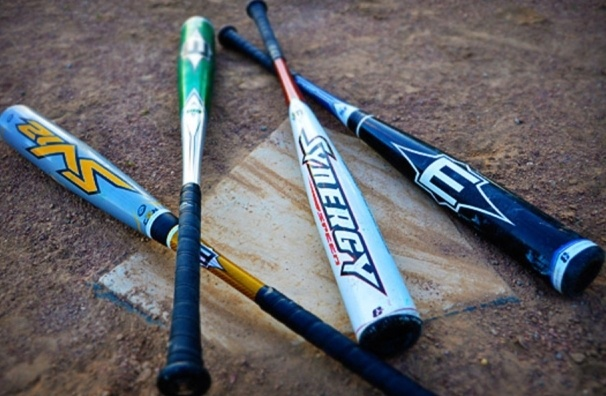 Softball bats on the ground.
