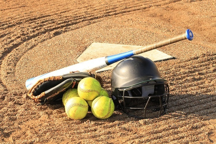 Softball gear on the ground.